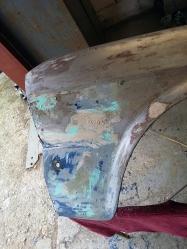 old fender with plenty of filler