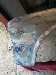 old fender with plenty of filler
